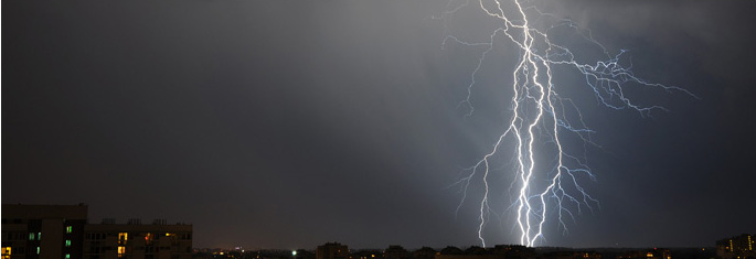 Picture of lightning strike behind a city